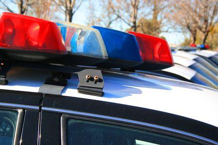 patrol cop: Polic�a coches aparcados en un parking.  Foto de archivo