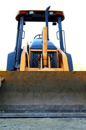 industrial park: Close up of a bulldozer in a construction sight.