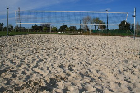 Beach volleyball court over bright blue sky. photo