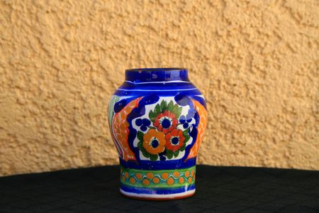 talavera: Talavera handpainted ceramic jar over cream and black background. Stock Photo