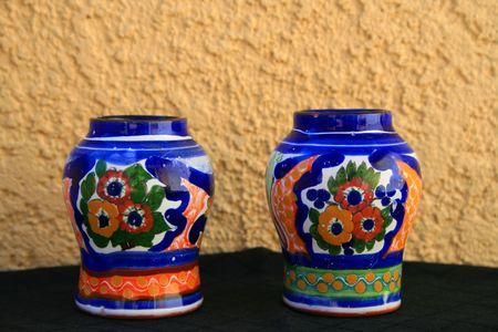 talavera: Talavera handpainted pottery over cream and black background.