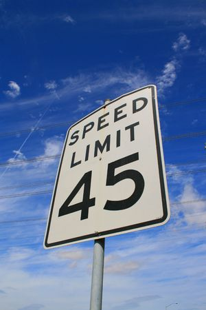sky is the limit: Speed limit road sign over blue sky.