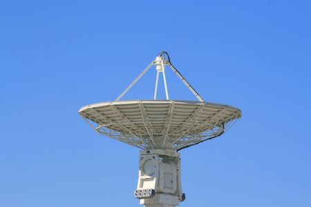 receiver: Big satellite dish over clear blue sky.