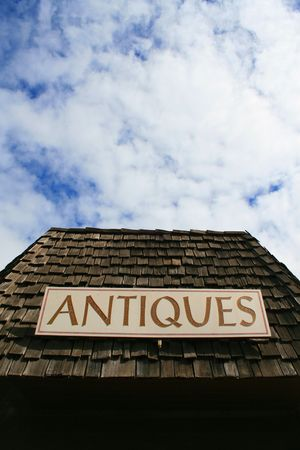 Close up of an antiques sign on top of a store. 写真素材