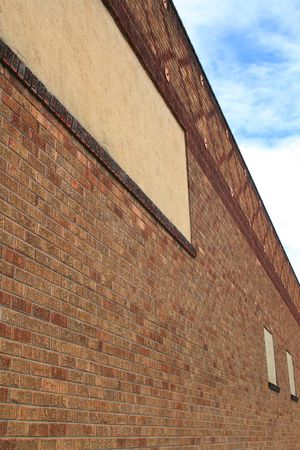 Brickwall over blue sky showing unique pattern.  photo