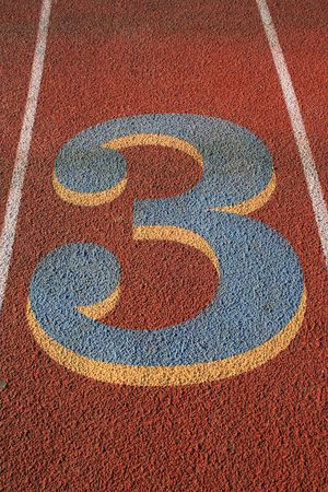 Number Three on a Running Lane Stock Photo