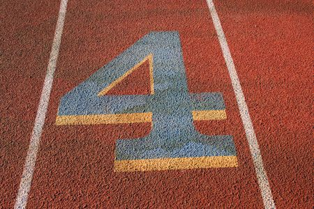 Number Four on a Running Lane photo