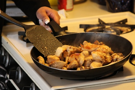 frying pan: Person Frying Food in a Fry Pan Stock Photo