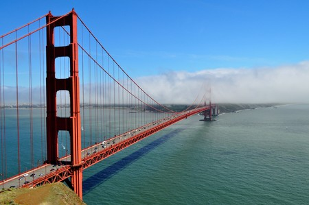 View of Golden Gate Bridge with fog rolling in from Pacific Ocean Stock Photo