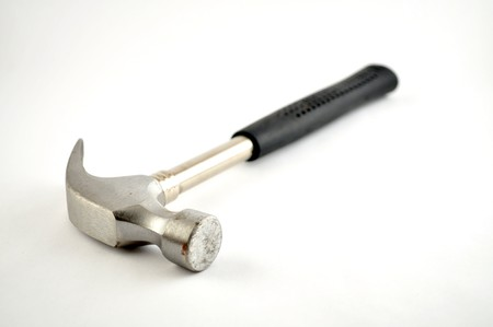 Up close with a hammer on a white background photo