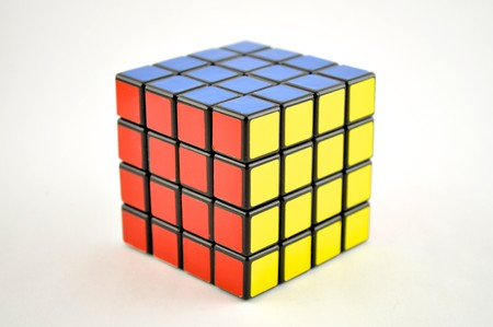 4 x 4 puzzle cube on a white background