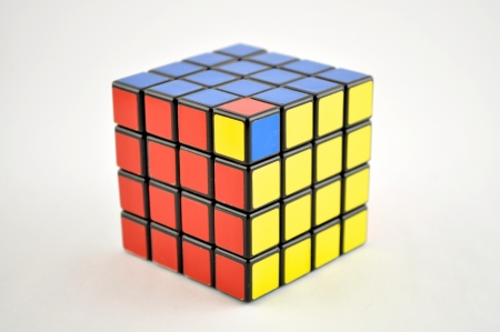 4 x 4 puzzle cube on a white background with one piece out of place