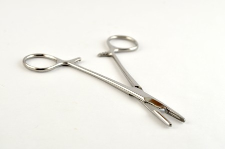 Open hemostat on a blank white background