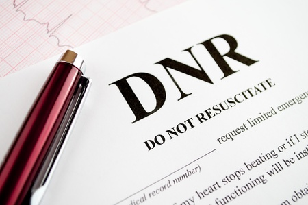 Do Not Resuscitate (DNR) form with pen and EKG tracing Stock Photo