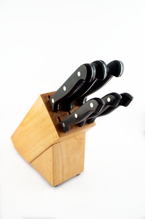 Set of steel knives in a wooden block