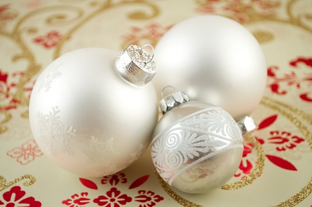 Glass christmas ornaments with snowflakes on wrapping paper
