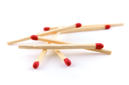 A group of match sticks on a white background Stock Photo