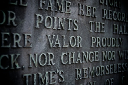 Valor spelled out on a copper monument with vignetting Stock Photo