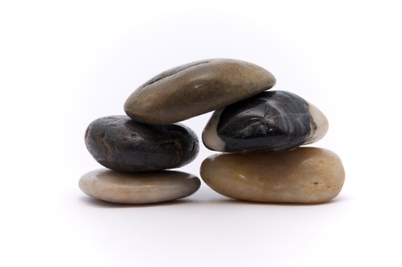 River stones stacked on a white background