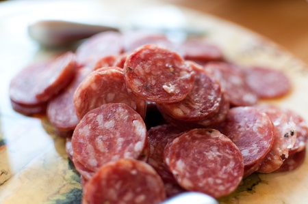 Salami sliced up and served on a Tuscan platter