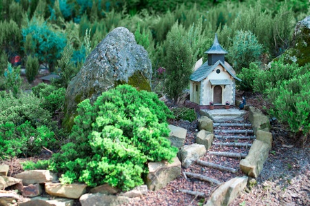 Miniature church with tiny forest in the background photo