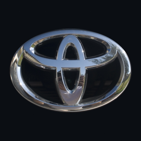 Toyota logo up close with shiny chrome finish Editorial