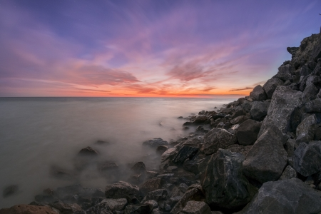 Sunset over a rocky beach