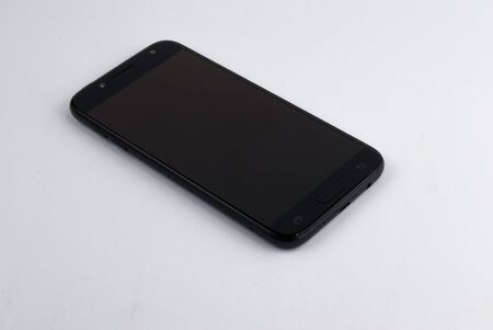 BLACK SMARTPHONE ON WHITE BACKGROUND.