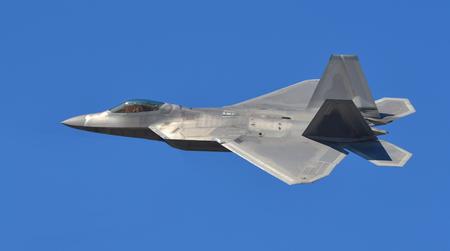 fighter jet: F-22 Raptor Fighter Jet Flying Editorial