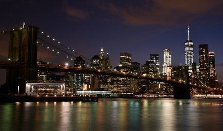 The Brooklyn Bridge and skyline of downtown Manhattan from Brooklyn at night