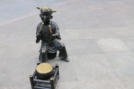 Childrens drumming sculpture