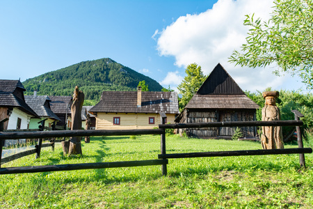 Vlkolinec, Ruzomberok / Slovakia - June 17, 2018: village of Vlkolinec, included in the UNESCO World Heritage. Its traditional little houses and wooden statues. Editorial