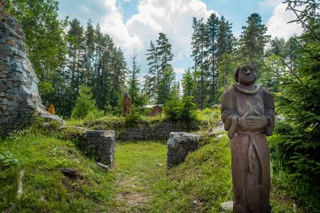Slovak Paradise, Letanovce / Slovakia - June, 19, 2018: wooden statue of a monk in the ruins of the Klastorisko monastery in the Slovak Paradise National Park