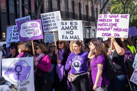 Palma de Mallorca, Spain - March 08, 2020: International Women's Day. Crowd of women of all ages holding banners in the feminist demonstration.