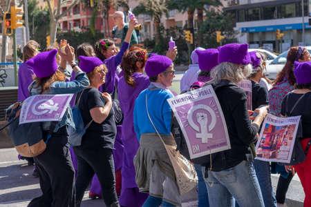 Palma de Mallorca, Spain - March 08, 2020: International Women's Day. Old women in a feminist protest, purple dressed. 新聞圖片