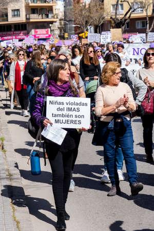 Palma de Mallorca, Spain - March 08, 2020: International Women's Day. Feminist protest, in the banner: NIÑAS VIOLADAS DEL IMAS TAMBIÉN SON MUJERES.