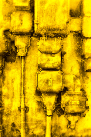 Old electrical cabinet textured in yellow.