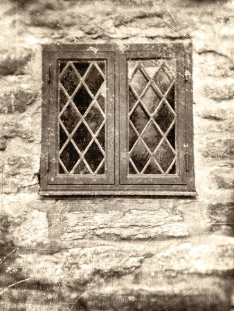 windowpane: Window with leaded windowpane surrounded by an old stone wall, textured in sepia vintage style with scratches and stains.
