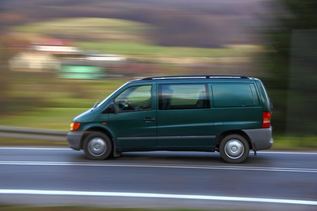 Speedy green van on the road
