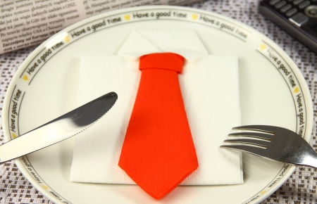 Concept lunch made by business shirt and tie photo
