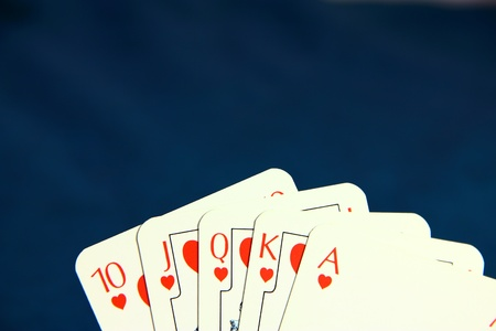 Playing poker cards on dark blue background Stock Photo - 8591514