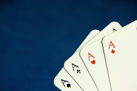 Playing poker cards on dark blue background photo