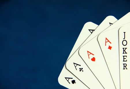 Playing poker cards on dark blue background Stock Photo - 8591512