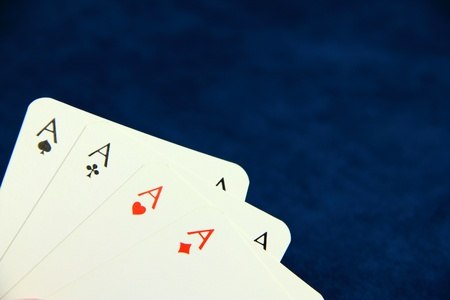 Playing poker cards on dark blue background Stock Photo - 8591513