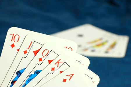 Playing hazard game by poker cards on dark blue background Stock Photo - 8683007