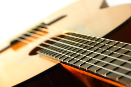 Details of classic spanish wooden guitar photo