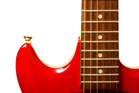 Details of red electric modern guitar photo