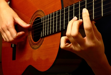 Closeup view of playing classic spanish guitar Stock Photo