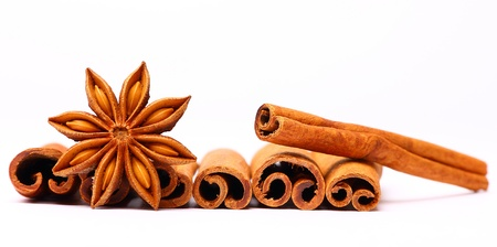 Anise star and several cinnamon bars isolated Stock Photo