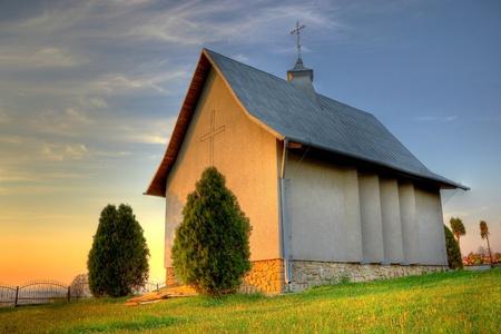 catholic chapel: Small catholic chapel on a cementery at warm evening light Stock Photo